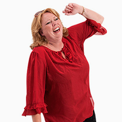 Karen-Marie wearing a red blouse is bursting with laughter